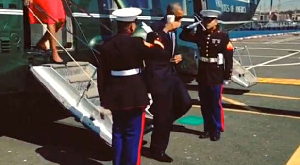 Barack Obama saluting Marines with coffee cup