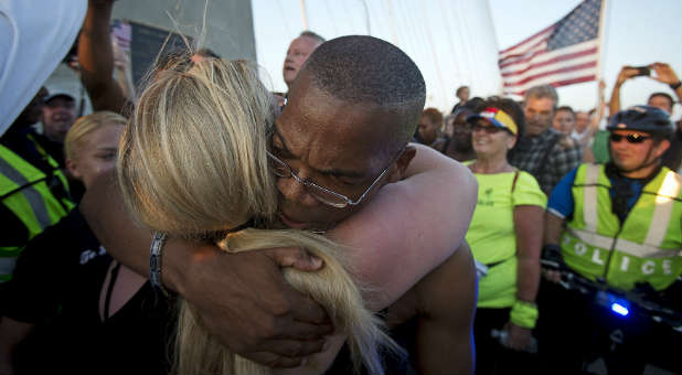 A man and woman hug outside Emanuel AME Church in Charleston.