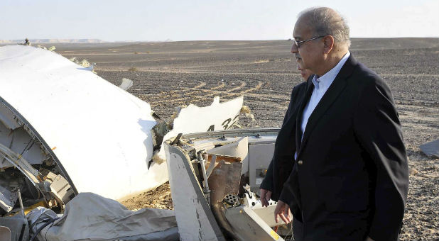 Egypt's Prime Minister Sherif Ismail looks at the remains of a plane crash in the central Sinai desert near El Arish in northern Egypt.