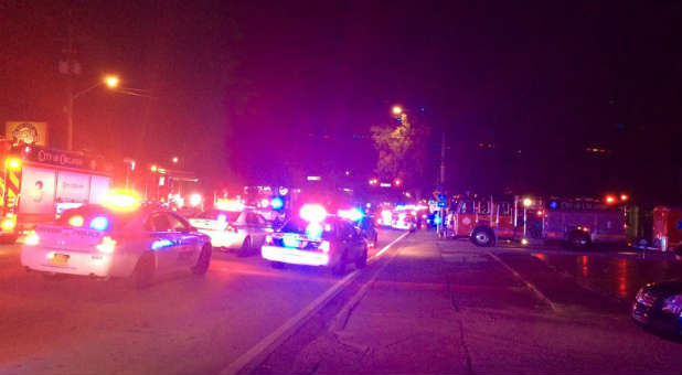 Police cars and fire trucks are seen outside the Pulse night club where police said a suspected gunman left multiple people dead and injured in Orlando, Florida.