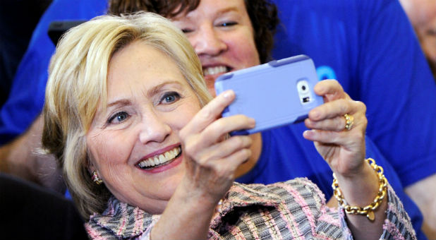 "U.S. Democratic presidential candidate Hillary Clinton takes a ""selfie"" with a supporter after a campaign rally at the Omaha North High Magnet School in Omaha, Nebraska"