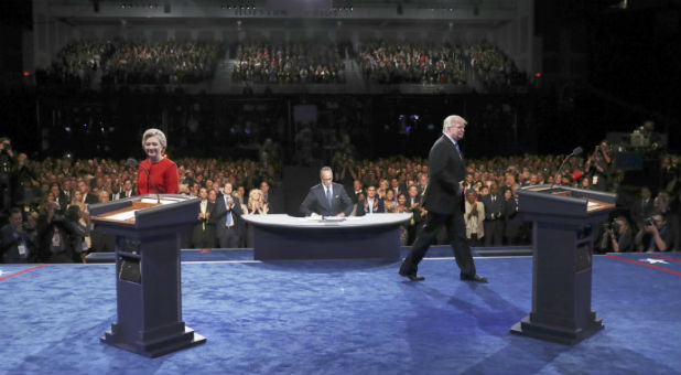 Republican U.S. presidential nominee Donald Trump and Democratic U.S. presidential nominee Hillary Clinton walk on the stage during their first presidential debate at Hofstra University in Hempstead
