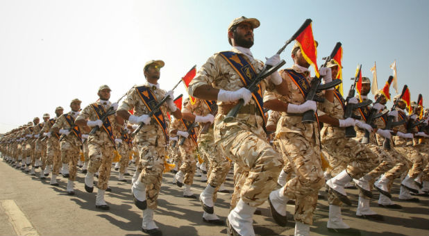 Members of the Iranian revolutionary guard march during a parade to commemorate the anniversary of the Iran-Iraq war