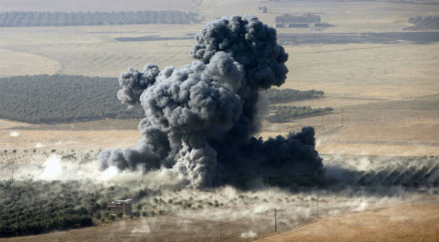 Smoke rises at Islamic State militants' positions in the town of Naweran