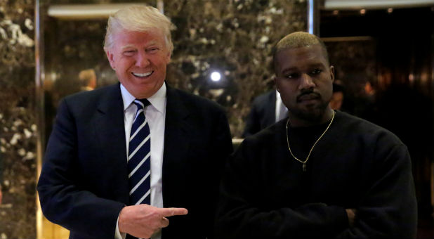 President-elect Donald Trump and Kanye West pose for media at Trump Tower in Manhattan.
