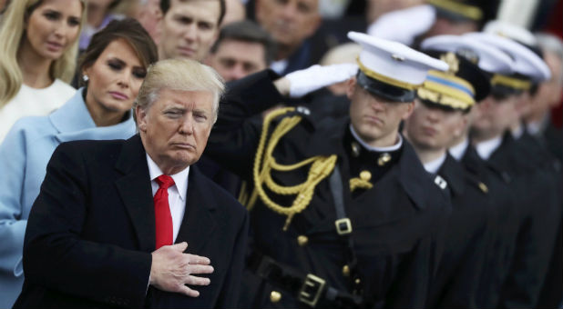 President Donald Trump listens to the national anthem after inauguration ceremonies swearing him in as the 45th president of the United States on the west front of the U.S. Capitol in Washingto