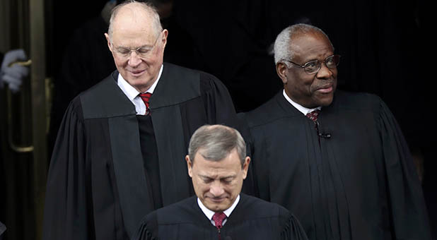 Chief Justice John Roberts and Associate Justices Clarence Thomas and Anthony Kennedy