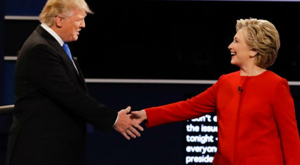 Donald Trump shakes hands with opponent Hillary Clinton.
