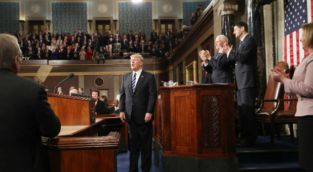 U.S. President Donald Trump is applauded after delivering his first address to a joint session of Congress from the floor of the House of Representatives in Washington.
