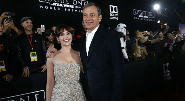 "Actress Felicity Jones and Chief Executive Officer of Disney Bob Iger arrive at the world premiere of the film ""Rogue One: A Star Wars Story."""