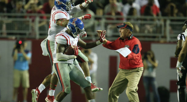 Mississippi Rebels head coach Hugh Freeze reacts with his defense