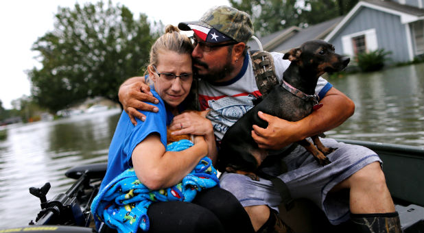 Texas refugees cling to their pets as they search for safety.