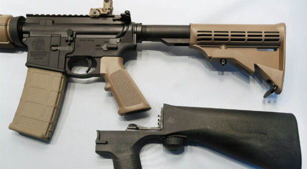 A bump fire stock that attaches to an semi-automatic assault rifle to increase its firing rate.