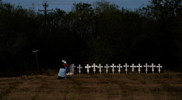 Crosses are placed near a vigil in the memory of those killed in the shooting at the First Baptist Church of Sutherland Springs, Texas.