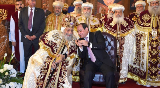 Egyptian Coptic Pope Tawadros II (L), Pope of the Coptic Orthodox Church of Alexandria and Patriarch of Saint Marc Episcopate receives Egyptian President Abdel Fattah al-Sisi (R), at the new Coptic Cathedral.