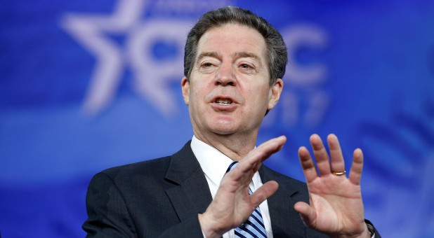 Kansas Gov. Sam Brownback is now the ambassador for religious freedom.