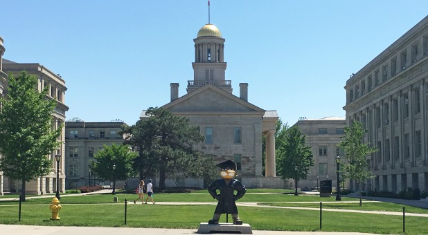 School mascot Herky the Hawk stands in front of the Old Capitol Museum at the University of Iowa, in Iowa City, Iowa.