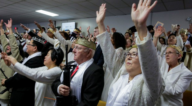 People with their AR-15-style rifles attend a blessing ceremony at the Sanctuary Church in Newfoundland, Pennsylvania.
