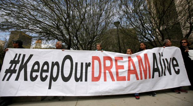 Members of the Border Network for Human Rights and Borders Dreamers and Youth Alliance (BDYA) hold a banner during protest outside a U.S. federal courthouse to demand that Congress pass a Clean Dream Act.