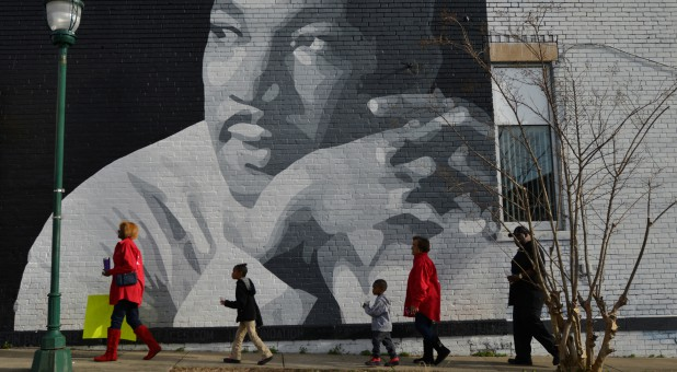 People gather to march in the annual parade down MLK Boulevard to honor Martin Luther King, in Chattanooga, Tennessee.
