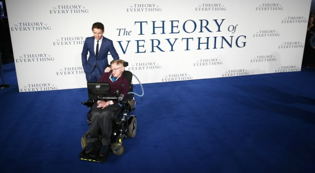 "Actor Eddie Redmayne poses with Stephen Hawking as they arrive at the U.K. premiere of the film ""The Theory of Everything,"" which is based around Stephen Hawking's life, at a cinema in central London, Dec. 9, 2014."