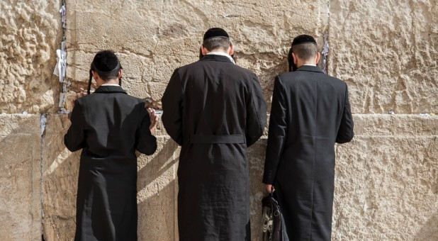 Men pray at the Western Wall in Israel.