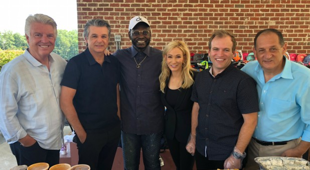 Jack Graham, Jentezen Franklin, Harry Jackson, Paula White and Todd Lamphere visit migrant children.