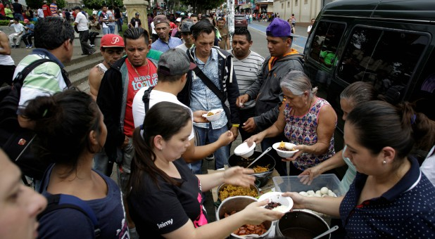 Nicaraguan refugees fleeing their country due to unrest receive food as they gather in San Jose, Costa Rica.