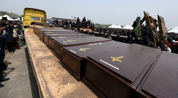 A truck carries the coffins of people killed by the Fulani herdsmen.