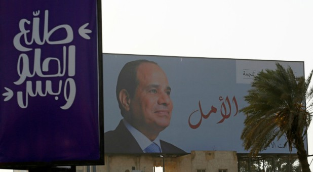 An election campaign billboard featuring Egyptian President Abdel Fattah el-Sisi.