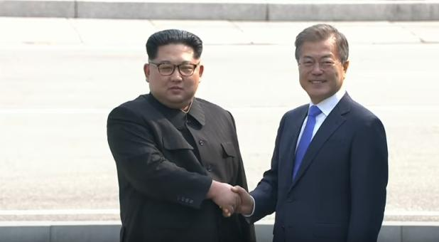 North Korean Supreme Leader Kim Jong-un and South Korean President Moon Jae-in shake hands at a historic summit.