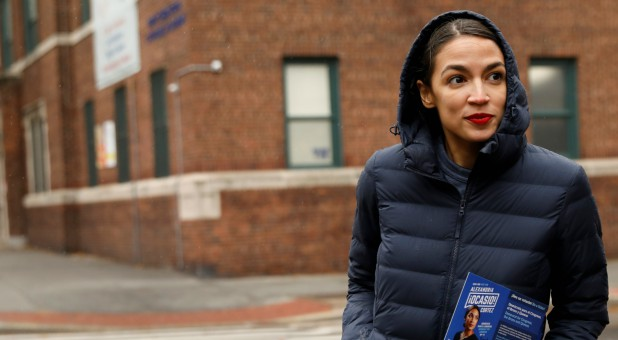 Democratic Congressional candidate Alexandria Ocasio-Cortez campaigns during a whistle stop in the Queens borough of New York City.