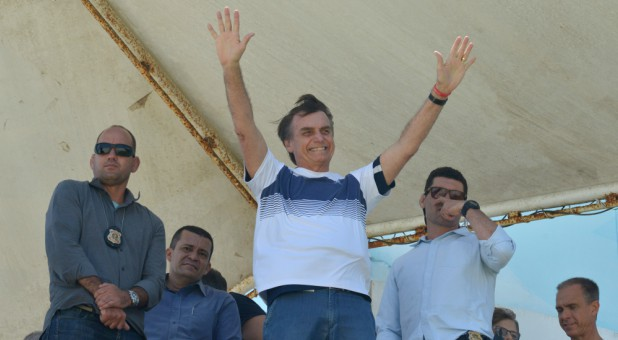 Brazil's new president-elect, Jair Bolsonaro, waves to supporters.