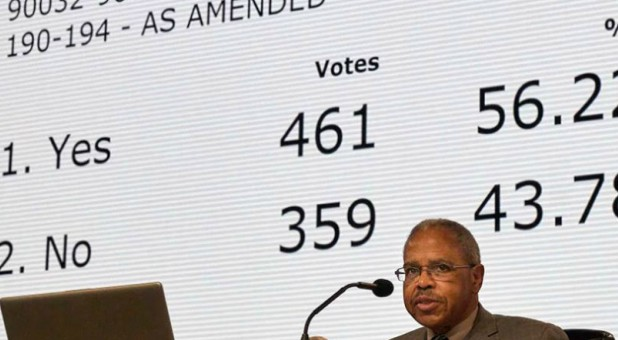 Rev. Joe Harris presides over the results of a vote about the so-called Traditional Plan/