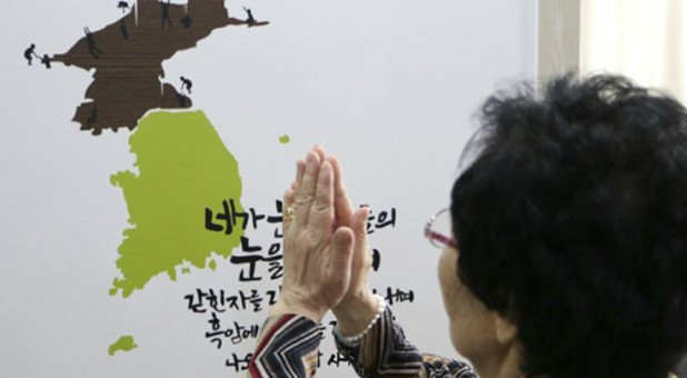 A woman prays for North Korea.
