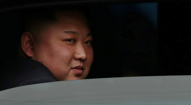 North Korea's leader Kim Jong Un sits in his vehicle after arriving at the Dong Dang railway station, Vietnam.