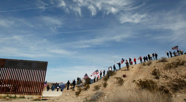 U.S. demonstrators holding U.S. flags gather at the open border to make a human wall in support of the construction of the new border wall between U.S. and Mexico, in Ciudad Juarez, Mexico.