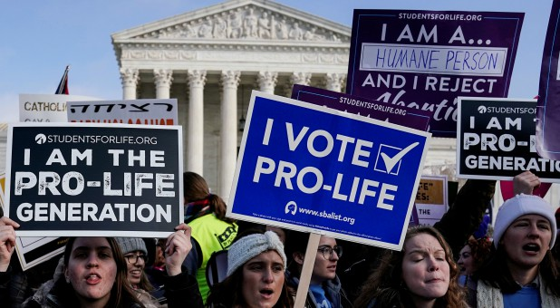Anti-abortion marchers rally at the Supreme Court during the 46th annual March for Life in Washington.