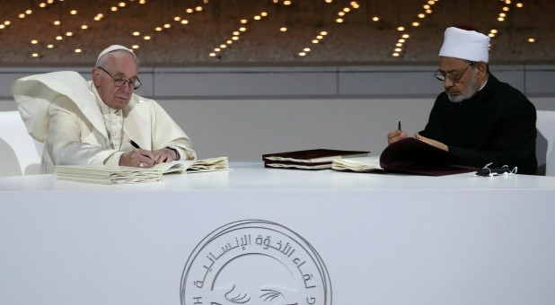 Pope Francis and Grand Imam of al-Azhar Sheikh Ahmed al-Tayeb signing a document on fighting extremism, during an inter-religious meeting.