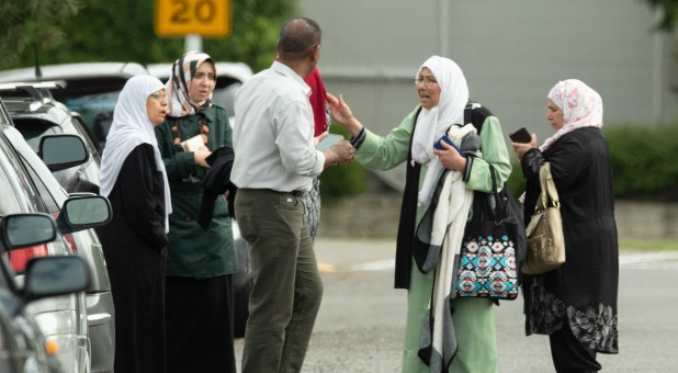 Members of a family react outside the mosque following a shooting at the Al Noor mosque in Christchurch.