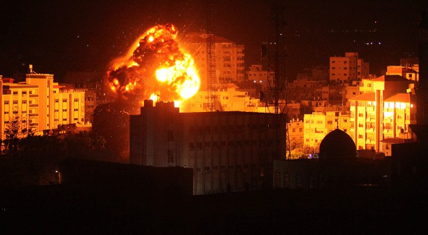 Flame and smoke are seen during an Israeli air strike in Gaza City.