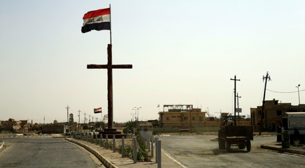 A big cross is seen at the entrance of the town of Qaraqosh, Iraq.