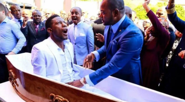 "Pastor Alph Lukau, right, alleged to resurrect ""Elliot"" through God's work on Feb. 24, 2019, at Alleluia International Ministries in Johannesburg, South Africa. The claim has been disputed."