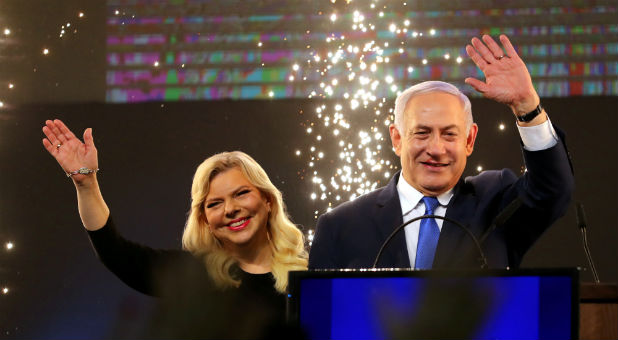 Israeli Prime Minister Benjamin Netanyahu and his wife, Sara, celebrate a possible win in Israel's elections.