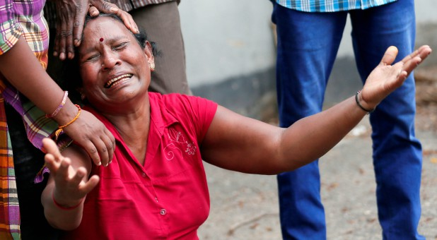 A relative of a victim of the explosion at St. Anthony's Shrine, Kochchikade church, reacts at the police mortuary in Colombo, Sri Lanka.