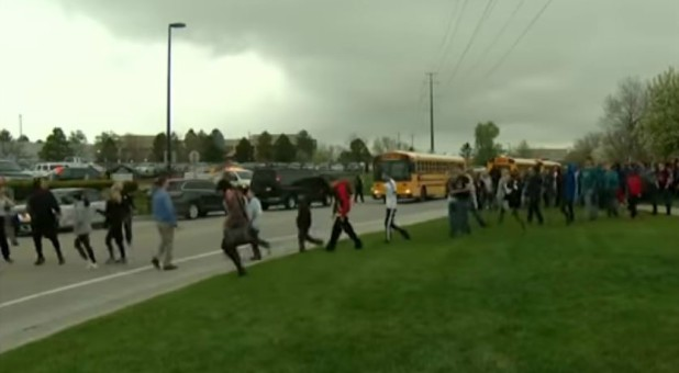 Students evacuate after a school shooting.