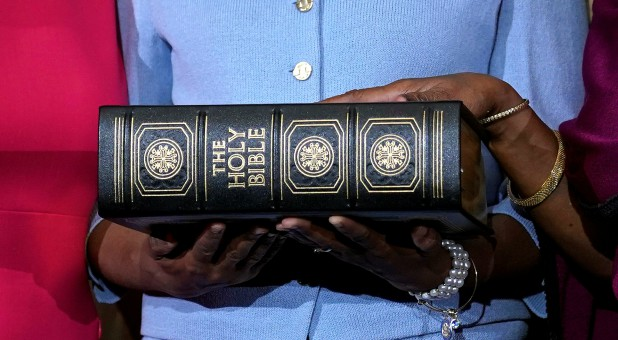 Rep. Sheila Jackson Lee (D, Texas) poses with a Bible.