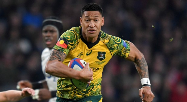 Australia's Israel Folau runs in to score their first try.