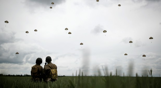 Paratroopers jump during a commemorative parachute jump over Sannerville in Normandy as France prepares to commemorate the 75th anniversary of the D-Day, France.