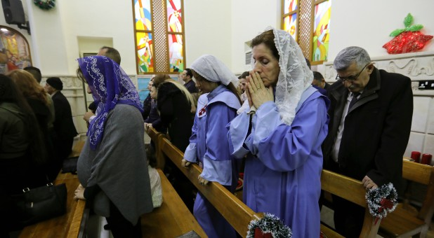 Iraqi Christians pray during a mass on Christmas at St George Chaldean Catholic Church in Baghdad, Iraq.